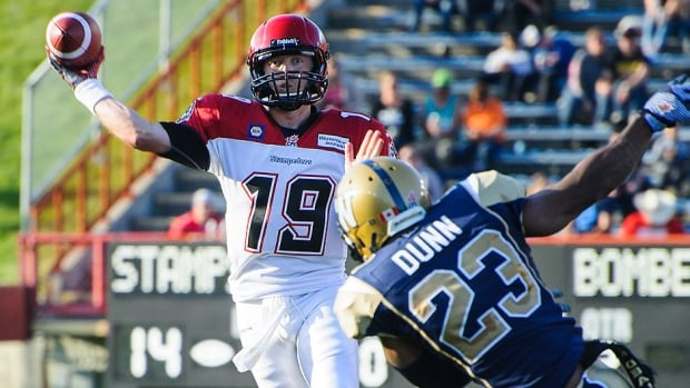 Stampeders quarterback Bo Levi Mitchell makes the pass before Desia Dunn of the Blue Bombers can stop him during a CFL pre-season game at McMahon Stadium in Calgary on Saturday. Mitchell went 8-for-11 for 76 yards and also engineered a lengthy scoring drive while splitting duties with Drew Tate in the first half. Calgary won 23-20.