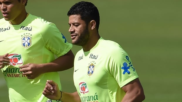 Brazil striker Hulk practised for 15 minutes Sunday before leaving with an apparently leg injury.