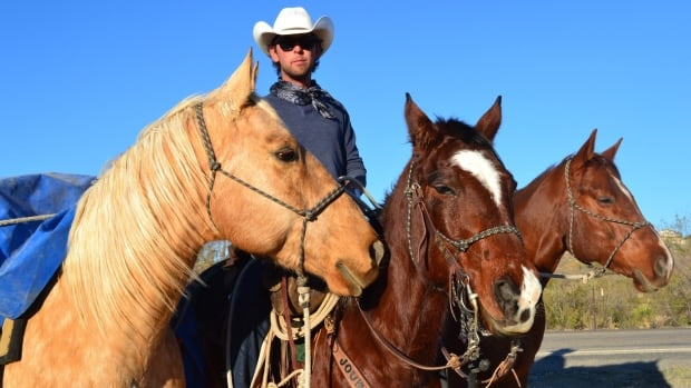 In this photo taken Thursday, Nov. 29, 2012, Filipe Masetti Leite rides into Carlsbad, N.M. Inspired by his love for horses and an old story he has known since boyhood, the 27-year-old embarked on an epic journey through 10 countries on horseback.