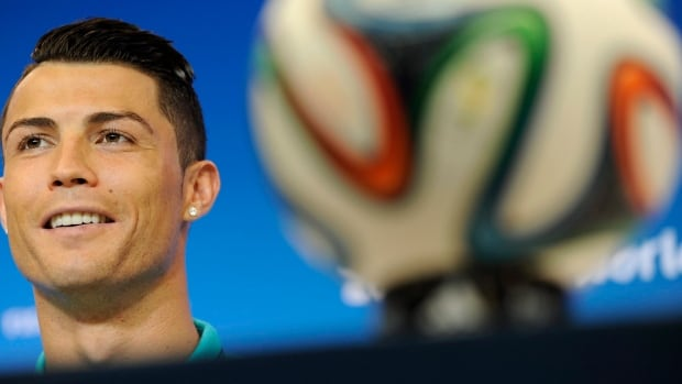 Portugal's Cristiano Ronaldo attends a news conference Sunday, the day before the group G World Cup soccer match between Germany and Portugal.