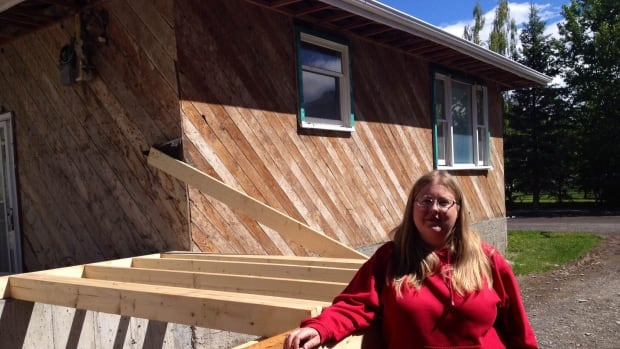 Jennifer Smith of Exshaw is still living in a trailer while the damage done to her home in last year`s flood is repaired.