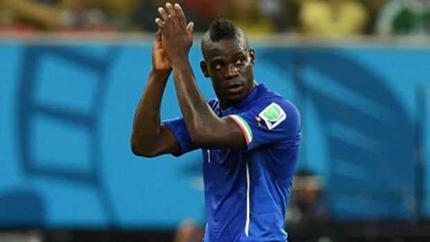Italy's Mario Balotelli, who scored the winning goal off a header, acknowledges the fans after the Italians defeated England 2-1 in a Group D match on Saturday.