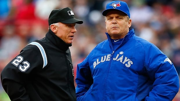 John Gibbons, right, has skippered the Toronto Blue Jays to the top of the American League East Division standings this season.