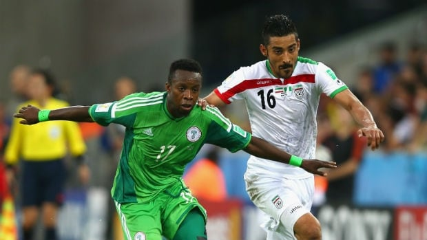 Ogenyi Onazi of Nigeria, left, competes for the ball with Reza Ghoochannejhad of Iran.