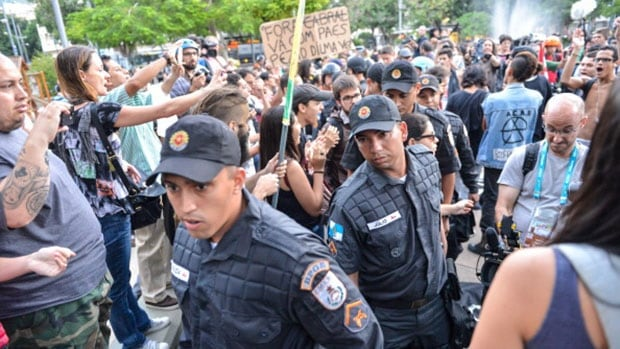 Anti-World Cup protestors gather to march to Maracana Stadium while police take security measures in Rio de Janeiro, Brazil.
