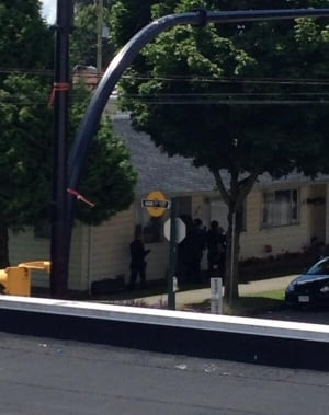 Police ERT team enter house believed to hold axe-wielding man