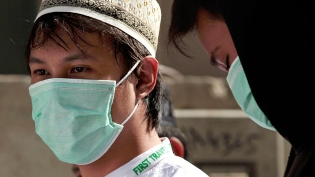 Muslim pilgrims, pictured in May, wear surgical masks to help prevent infection from a respiratory virus known as the Middle East Respiratory Syndrome (MERS) in the holy city of Mecca, Saudi Arabia.