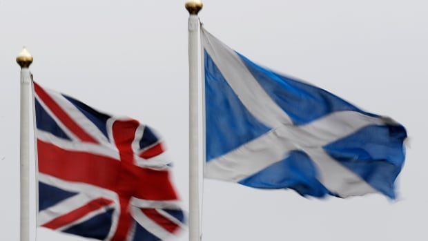 The Union flag (left) gets some of its defining features, such as its blue background and white diagonal cross, from Scotland's Saltire. The Union Jack could lose those features if Scotland votes to become independent.
