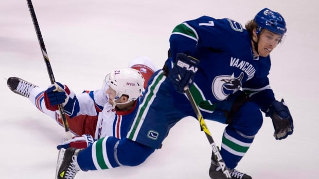 Vancouver Canucks left wing David Booth battles during an April 1 game at Rogers Arena.