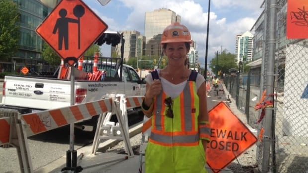 Flag person Heather Guy says she smiles at drivers to help reduce frustration as they go through a construction zone.