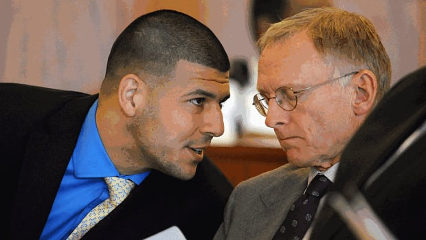 Ex-Patriots tight end Aaron Hernandez, left, talks with one of his defence attorneys, Charles Rankin, during a hearing at the Bristol County Superior Court House in Fall River, Mass., on Monday. Hernandez's attorneys asked a judge on Tuesday to approve their subpoena to the NFL team for its medical, psychological and other records on the former player.
