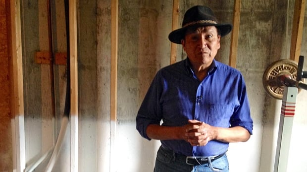 Roland Rollinmud, an artist on the Stoney Nadoda reserve, is still waiting for repairs to be completed on his basement studio.