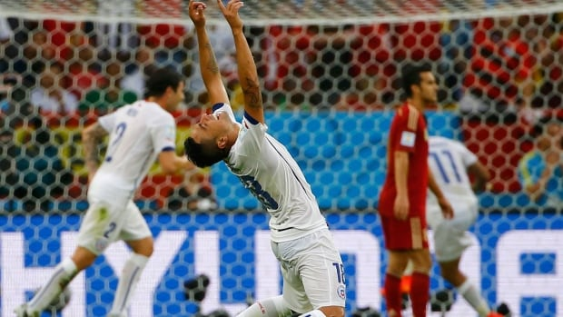 Chile's Gonzalo Jara celebrates a goal and the ouster of defending World Cup champions, Spain.
