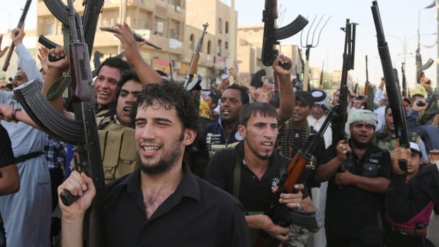 Shia tribal fighters raise their weaponsagainst the al-Qaeda-inspired Islamic State of Iraq and Syria (ISIS) in the northwest Baghdad's Shula neighborhood this week. Around 150 Australians have fought with radical militants in Syria and Iraq, raising government fears of a terrorist threat to Australia if the fighters return home.