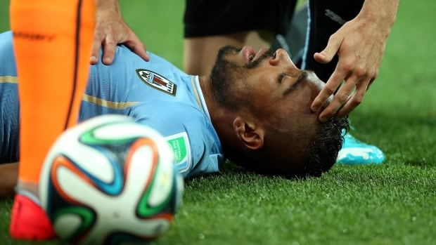 Uruguay's Alvaro Pereira lays motionless after taking a knee to the head in his team's match against England at the FIFA World Cup.