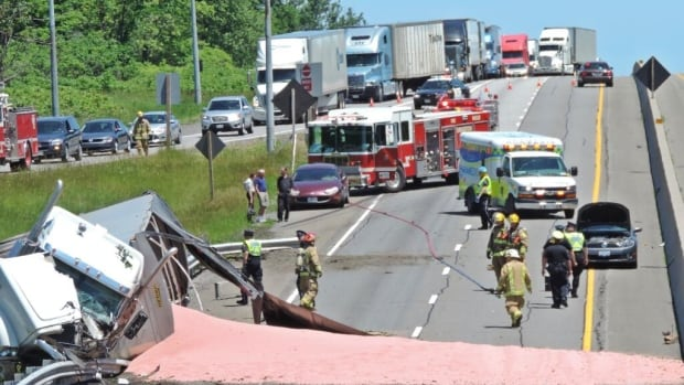 A tractor trailer spilled 40,000 pounds of potash onto Highway 401's westbound lanes on Thursday afternoon.