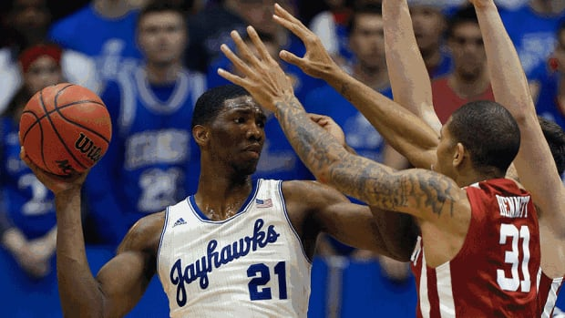 Joel Embiid of the Kansas Jayhawks, one of the top three candidates the Cleveland Cavaliers were considering for the No. 1 overall pick, has a fractured foot that could affect the top choices in next week's NBA draft. The versatile 7-footer earned Big 12