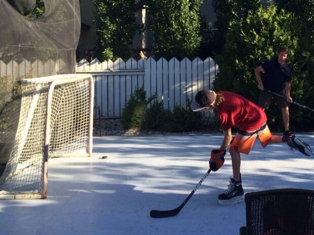 Synthetic Ice Rink Turns Saskatoon Yard Into Hockey Hot Spot - Backyard synthetic ice rink