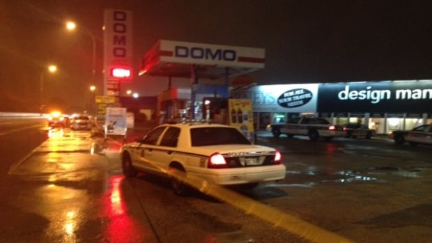 Police at the Domo gas bar on Wardlaw Avenue and Donald Street just before 10:30 p.m. on June 19.