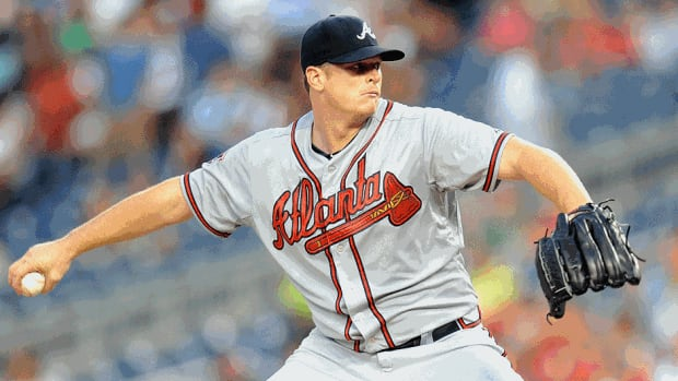 Gavin Floyd of the Braves pitches in the sixth inning against the hometown Nationals on Thursday in Washington, DC. He broke a bone in his elbow on his first pitch of the seventh inning.
