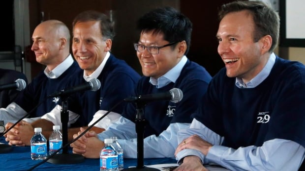 Scientists, from left, Clem Pryke, Jamie Bock, Chao-Lin Kuo and John Kovac, pictured during a March news conference, discussed their findings on the early expansion of the universe. In a new paper, the scientists stand by their initial conclusions, but say they can not rule out that a crucial signal came from Milky Way galaxy dust.