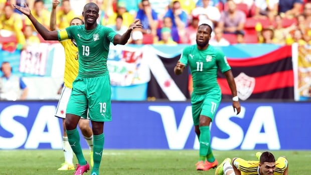 Yaya Toure, left, is Ivory Coast's captain. He hasn't made a decision if he'll remain with the team after hearing news that his brother died on Friday. Another Toure brother, Kolo, also plays for the squad.