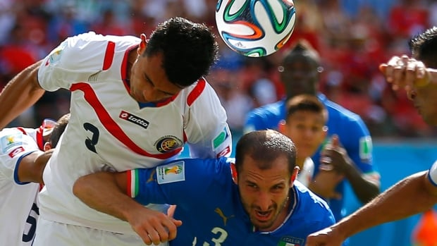 Italy's Giorgio Chiellini, right, fights for the ball with Costa Rica's Giancarlo Gonzalez during Friday's World Cup Group D match at the Pernambuco arena in Recife, Brazil.
