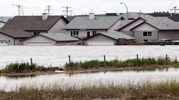 The High River area of Hampton Hills is shown during the 2013 floods in Alberta. The cost of that flood helped focus policy-makers' attention on the problems associated with extreme weather.