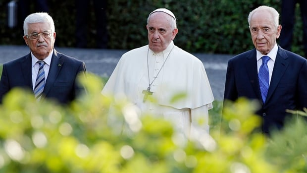 Palestinian President Mahmoud Abbas, Pope Francis and Israeli President Shimon Peres arrive in the Vatican Gardens to pray together on June 8, 2014. Politics is love, Francis said later.