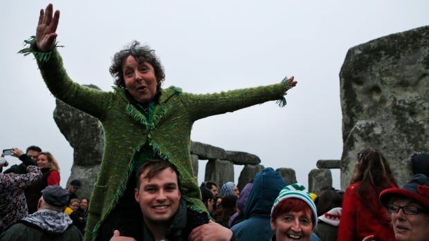 People dance during the summer solstice at the prehistoric Stonehenge monument near Salisbury, England on June 21, 2013.