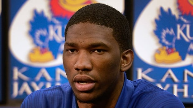 Joel Embiid had two screws placed in his right foot on Friday to repair a stress fracture.