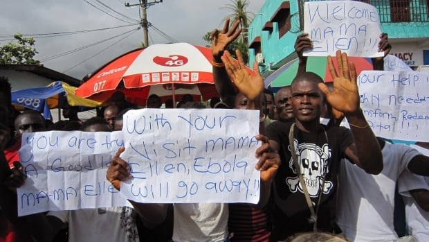 People protest outside a hospital as Liberia President Ellen Johnson Sirleaf visits the area after Ebola deaths in Monrovia, Liberia.
