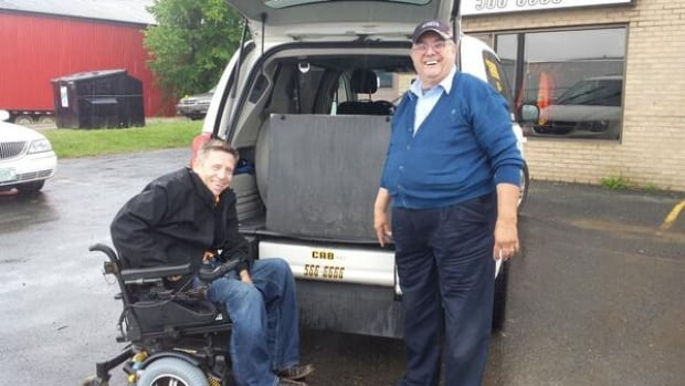 Paul Cudmore (left) says Charlottetown's first wheelchair-accessible taxi will give people like him greater freedom.