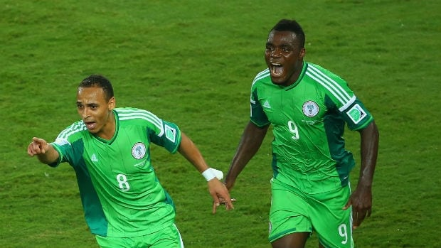 Peter Odemwingie, left, celebrates scoring Nigeria's first goal with teammate Emmanuel Emenike during a match at the 2014 FIFA World Cup. Clive