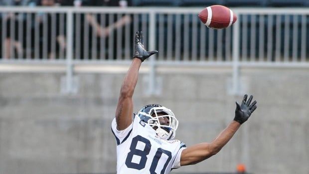 The ball flies out of reach of Romby Bryant of the Toronto Argonauts in a pre-season game against the Winnipeg Blue Bombers on June 9.