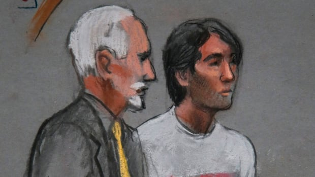 Khairullozhon Matanov, right, is seen in this courtroom sketch with lawyer Paul Glickman last month in federal court in Boston.