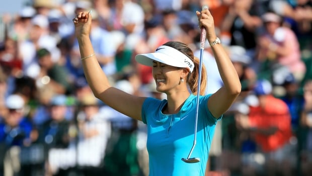 Michelle Wie of the United States celebrates her two-shot victory during the final round of the 69th U.S. Women's Open at Pinehurst Resort & Country Club on Sunday.