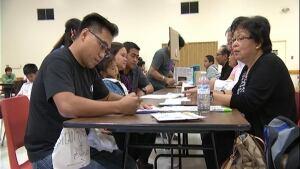 Filipinos getting passports renewed in Regina skpic
