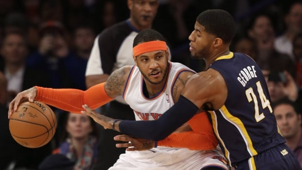 Carmelo Anthony, left, tries to move around Indiana's Paul George during a 2013-14 game at Madison Square Garden in New York.