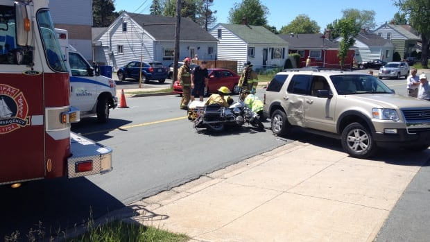 A motorcyclist suffered minor injuries Monday after a collision with an SUV turning left in Dartmouth.
