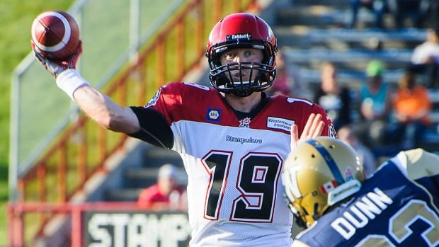 Bo Levi Mitchell, left, has been named the Stampeders' starting quarterback over Drew Tate to begin the season. He passed for 1,156 yards and 10 touchdowns last season.