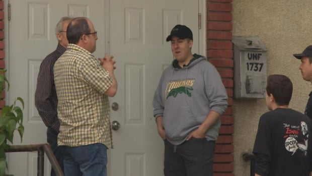 Brent Butt, in the checkered shirt, is on location in Regina filming scenes for Corner Gas: The Movie.