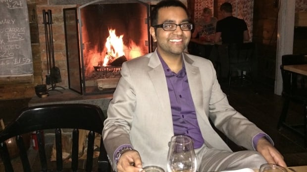 Dr. Nikhil Joshi celebrates the end of his cancer treatment earlier this year with a trip to a restaurant.