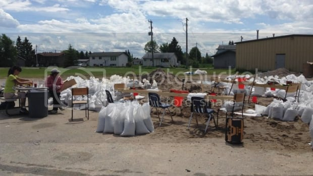 Couchiching First Nation has been sandbagging as a defence against flooding from the swelling Rainy Lake. Emergency resources coordinator Christine Jourdain says on Sunday, the community got an emergency funding commitment from the federal government to build a retaining wall to save a dozen homes on the shoreline.