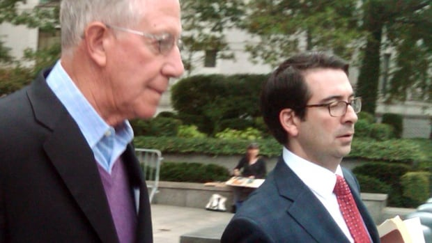 Paul Konigsberg, left, leaves court in New York with his lawyer, Reed Brodsky, Thursday, Sept. 26, 2013, after pleading not guilty to charges that he aided jailed financier Bernard Madoff in his Ponzi scheme.  Prosecutors say that he directed false bookkeeping that enabled Madoff to fool thousands of investors while he squandered nearly $20 billion of their money. (AP Photo/Larry Neumeister)