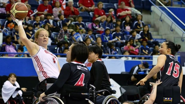 Canada's Janet McLachlan, left, shown here last Friday, scored a game-high 28 points against Great Britain Tuesday night.