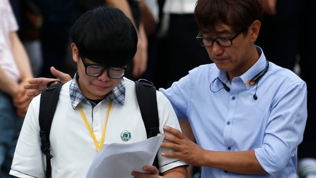 More than 70 survivors of South Korea's worst maritime disaster in 20 years made an emotional return to school on Wednesday, while families of the more than 300 students killed in the ferry sinking held vigil outside of the school.