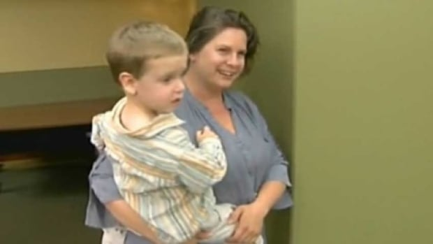 Three-year-old Luke Turner is carried by his mother, Brandy Turner, after the pair landed in Denver in May 2013. They were reunited in Brandon, Manitoba, where Luke had been found after being kidnapped by his father.
