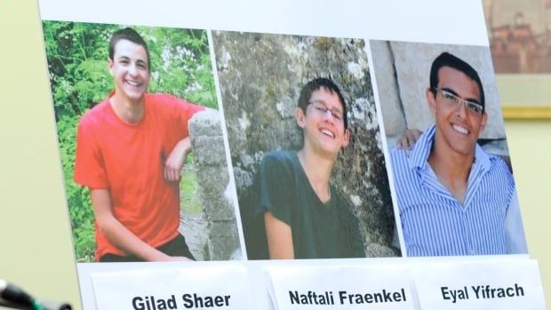 A photo of the three missing teens is displayed during a news conference on Capitol Hill in Washington on Tuesday, June 24, 2014.