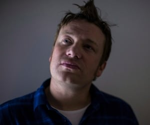 Jamie Oliver poses for a photo in Toronto in October 2013